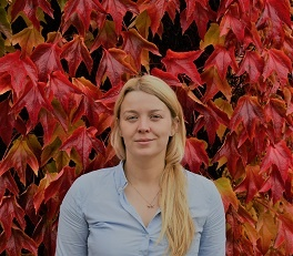 Profile picture of Jenny Lantair in a blue shirt in from of some autumnal Montana creeper