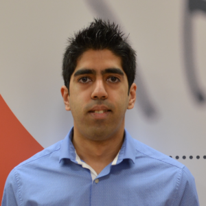 Profile picture of Adnan Ilyas wearing a blue shirt in front of a multi coloured background
